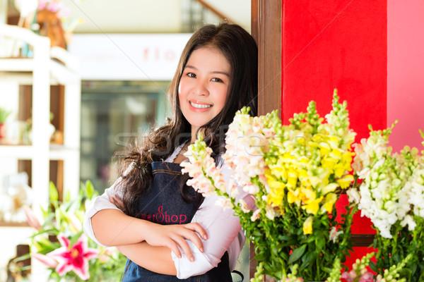 Asian Saleswoman in a flower shop Stock photo © Kzenon