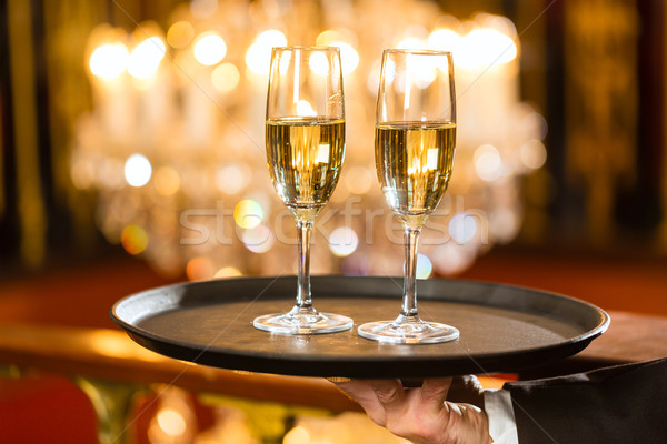 Waiter served champagne glasses on tray in restaurant Stock photo © Kzenon