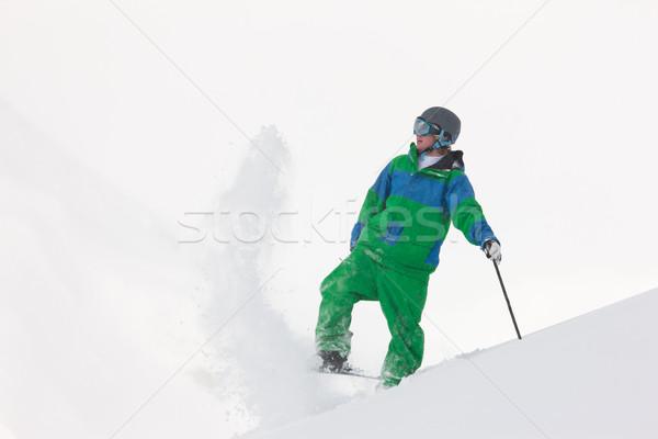 Skier dusting snow Stock photo © Kzenon