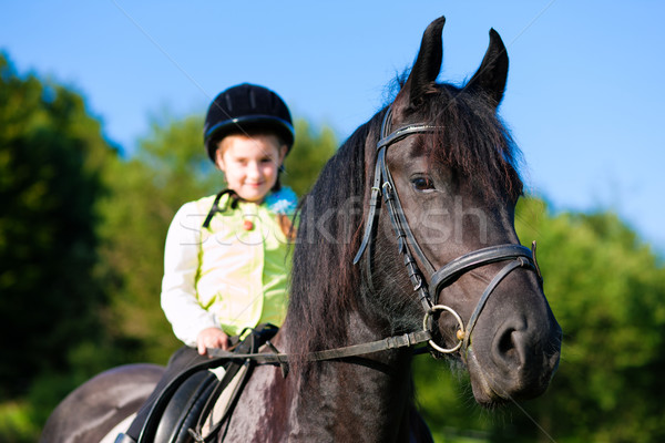 Little girl with horse Stock photo © Kzenon