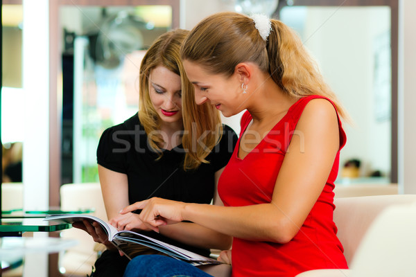Woman at the hairdresser getting advise Stock photo © Kzenon