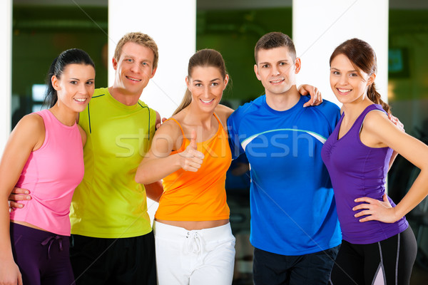 Group of people in gym Stock photo © Kzenon