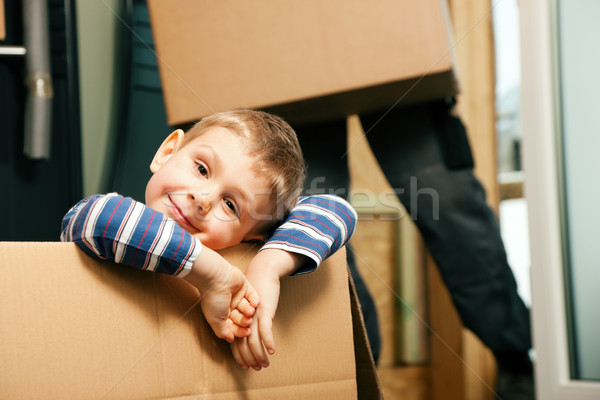 Family moving in their new house Stock photo © Kzenon