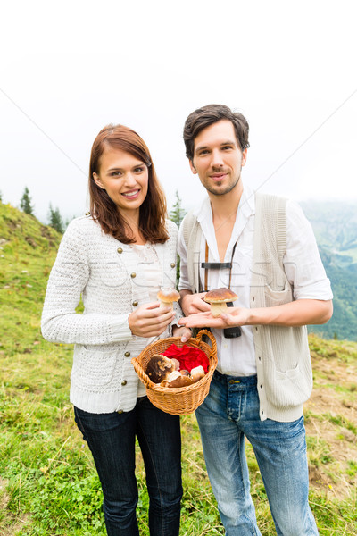 Young mushroom pickers in the Bavarian alps Stock photo © Kzenon
