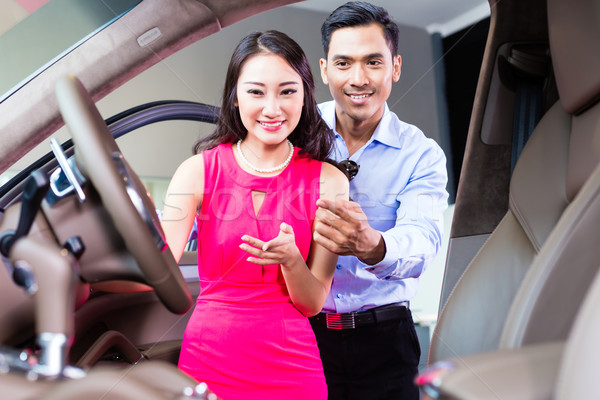 Asian couple choosing luxury car in dealership Stock photo © Kzenon