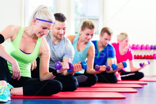 fitness people in gym working out with dumbbells Stock photo © Kzenon