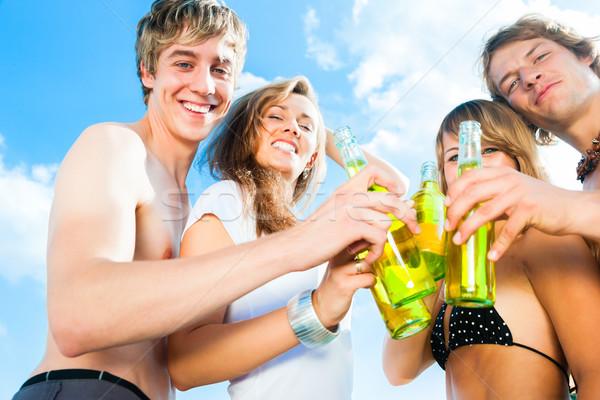 Celebrating party at beach Stock photo © Kzenon