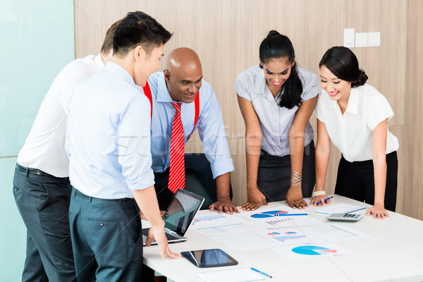 Asian business startup team in meeting Stock photo © Kzenon