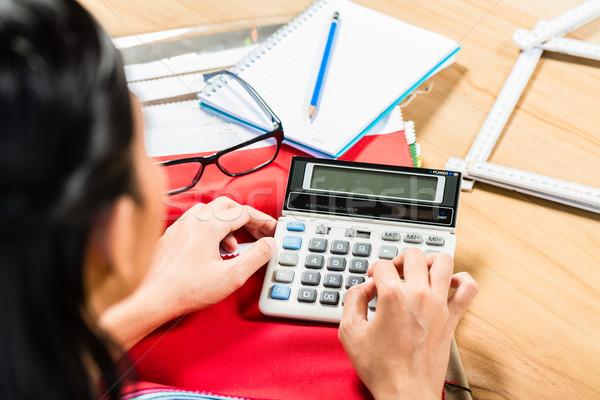 Interior designer calculating price Stock photo © Kzenon