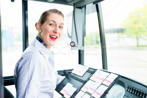 Bus bestuurder vrouw verkopen tickets zitting Stockfoto © Kzenon