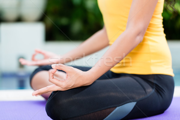 Young woman practicing yoga in lotus position outdoors Stock photo © Kzenon