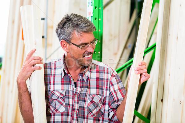 Customer in lumber department of hardware store Stock photo © Kzenon