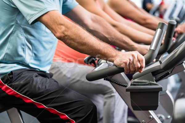Group spinning at the gym on fitness bikes  Stock photo © Kzenon