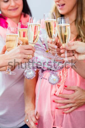 Friends clinking glasses on baby shower party Stock photo © Kzenon