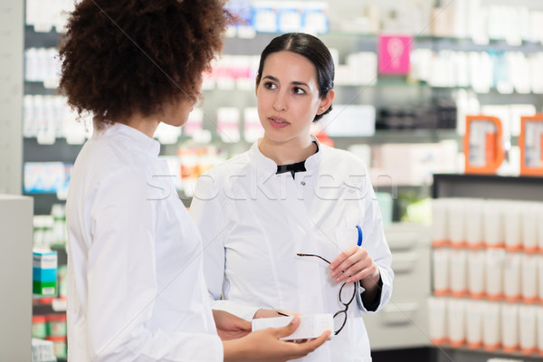 Side view of two dedicated pharmacists looking for the best medi Stock photo © Kzenon