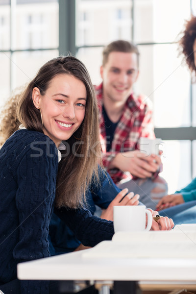 Millennial students watching together an online funny video Stock photo © Kzenon