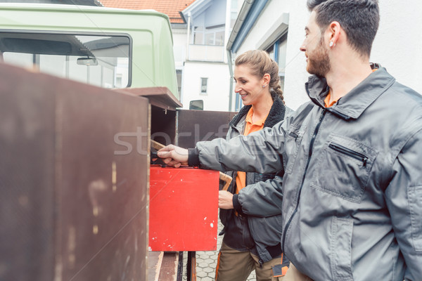 Two carpenter loading tools in mobile workshop transporter Stock photo © Kzenon