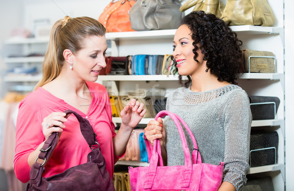Girlfriends in fashion store buying handbag  Stock photo © Kzenon