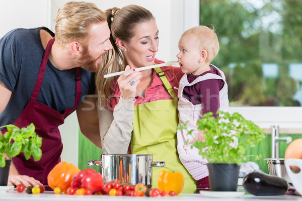 Mom, dad and child in kitchen Stock photo © Kzenon