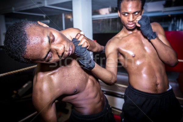African American quick fighter punching in the chin his opponent Stock photo © Kzenon