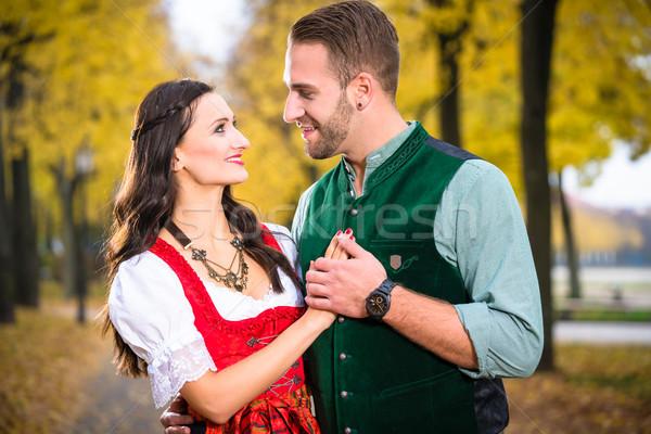 Bavarian Couple in autumn hug Stock photo © Kzenon