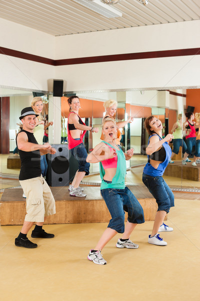 Zumba or Jazzdance - young people dancing in studio Stock photo © Kzenon