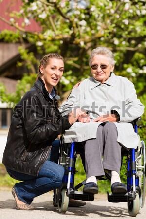 woman visiting her grandmother  Stock photo © Kzenon