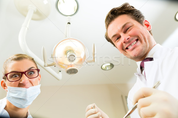 treatment at dentist from perspective of patient Stock photo © Kzenon