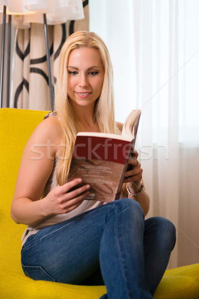 Young woman reading a book in hotel room Stock photo © Kzenon