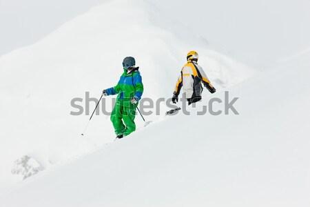 Snowbordos síel Alpok ugrik perem hó Stock fotó © Kzenon