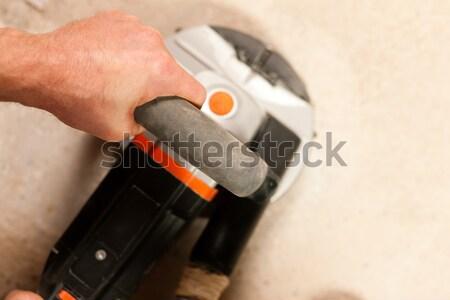 Cement vloer bouwvakker werken hand machine Stockfoto © Kzenon