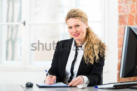 Lawyer in office with law book working on desk Stock photo © Kzenon