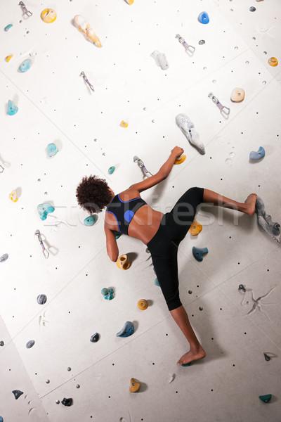 Woman at the climbing wall  Stock photo © Kzenon