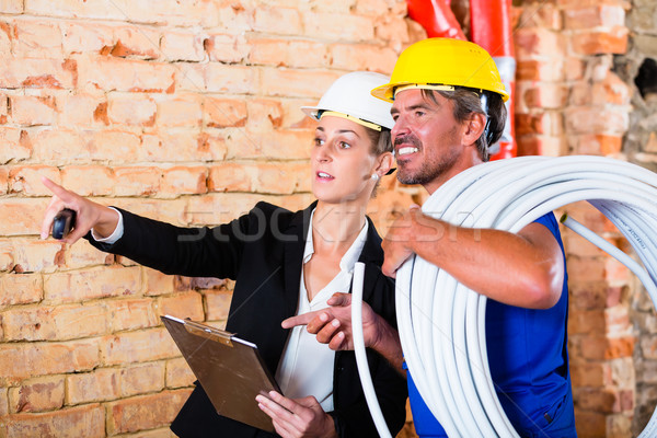 Builder and architect working on construction site Stock photo © Kzenon