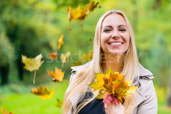 Woman in Autumn or fall with colorful foliage Stock photo © Kzenon