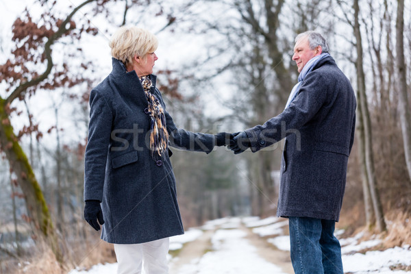 Senior woman and man saying goodbye Stock photo © Kzenon