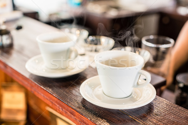 Cups of drip coffee on bar of coffee shop Stock photo © Kzenon
