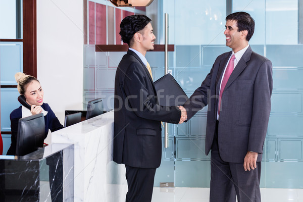 Manager welcoming business associate in office lounge Stock photo © Kzenon