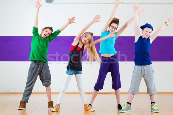 Kids train Zumba fitness in dancing school Stock photo © Kzenon