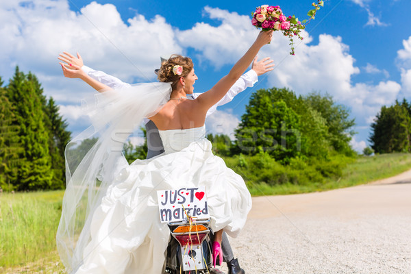 Wedding couple on motor scooter just married Stock photo © Kzenon