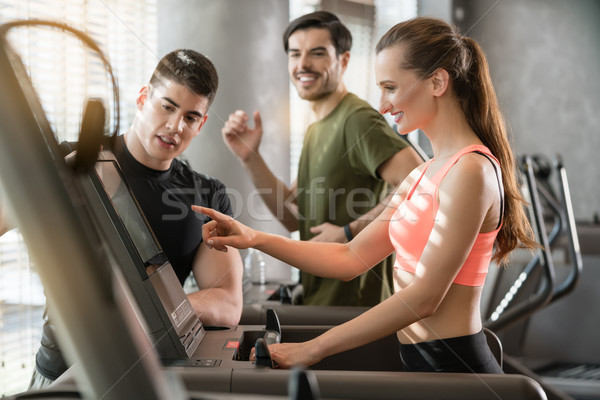 Young woman increasing the speed during a workout session superv Stock photo © Kzenon