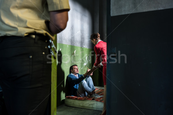 Dedicated female attorney visiting a young inmate in an obsolete Stock photo © Kzenon