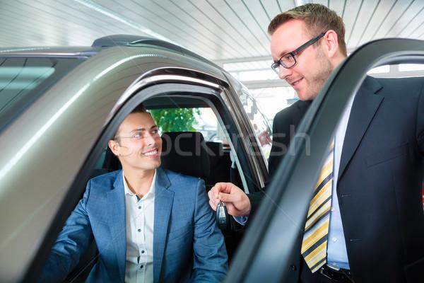 Customer buying new car in auto dealership  Stock photo © Kzenon