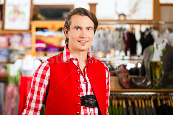 Man is trying Tracht or Lederhosen in a shop Stock photo © Kzenon