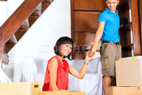 Asian couple moving in the new home Stock photo © Kzenon