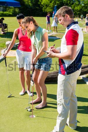 People playing miniature golf outdoors Stock photo © Kzenon