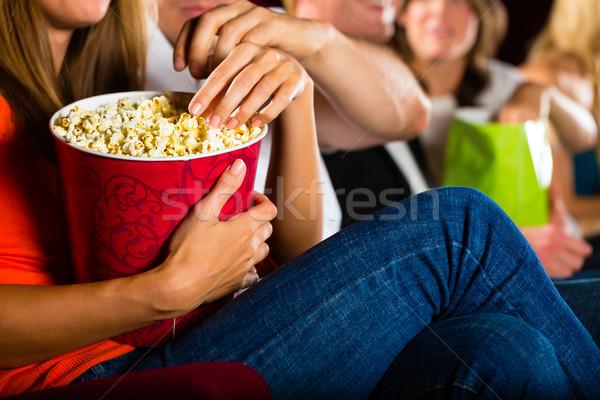 Girl eating popcorn in cinema or movie theater Stock photo © Kzenon