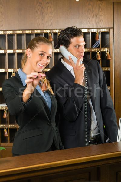 Reception in hotel - Man and woman Stock photo © Kzenon