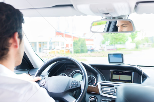 Young Taxi driver driving his car Stock photo © Kzenon