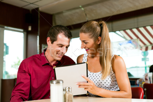 Couple order in a bar or restaurant Stock photo © Kzenon